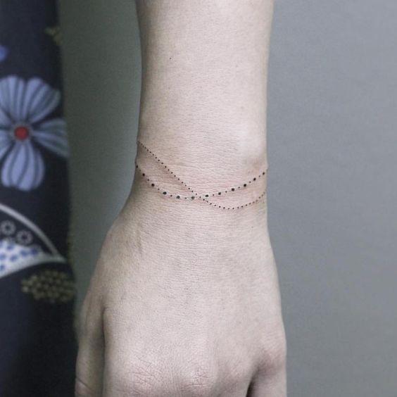 braçadeira de tatuagem de pontos